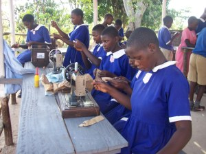 Pupils of Kikandwa Church of Uganda Primary Schools during a tailoring training class in the current Skills Development Center in Kikandwa Village.