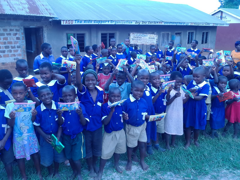Scholastic Material Donation to Kikandwa Primary School from Intel Volunteers delivered by Maendeleo Foundation